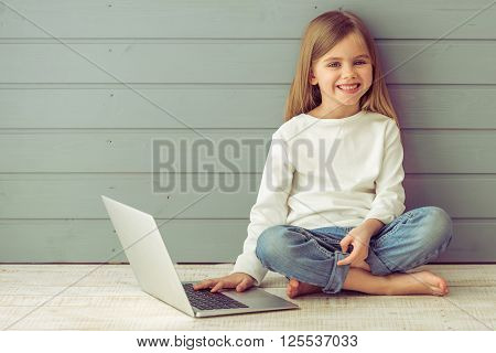 Little Girl With Gadget