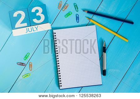 July 23rd. Image of july 23 wooden color calendar on blue background. Summer day. Empty space for text. National Hot Dog Day. World Whale and Dolphin DAY.