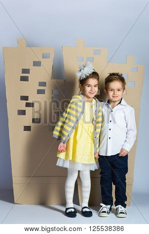 Love concept. Couple of kids. boy and girl with  cardboard town.