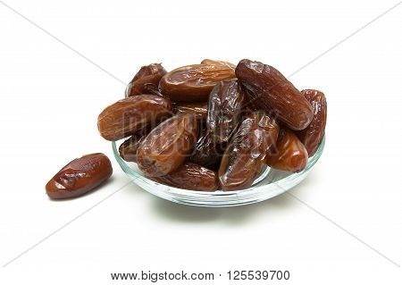Dried dates isolated on a white background isolated close-up. horizontal photo.
