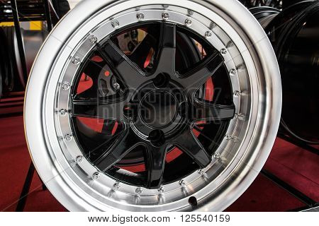 close up of automobile alloy wheels view
