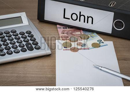 Lohn Written On A Binder