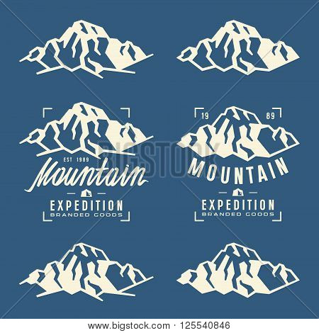 Mountain expedition labels badges and design elements. White print on blue background