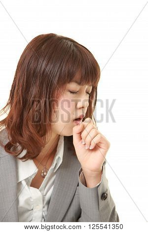 studio shot of young Japanese businesswoman coughing