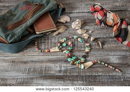 Vintage still life of random objects of modern woman on wooden board