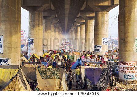 Allahabad, India - February 12, 2013: Crowd camping under the bridge at Kumbh Mela festival, the world's largest religious gathering, in Allahabad, Uttar Pradesh ,India.