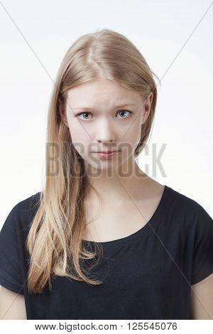 photo of beautiful funny teen girl grimacing