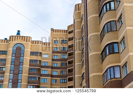 a modern multi storey residential building brick