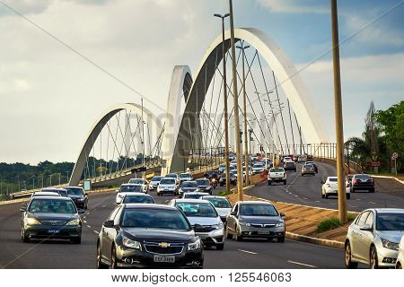 Brasilia, Brazil - November 19, 2015: Traffic on Juscelino Kubitschek bridge, aka JK Bridge, in Brasilia, capital of Brazil. Inaugurated in December 2002, the bridge instantly became a symbol of the city.