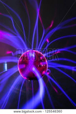 Plasma ball  with magenta-blue flames
