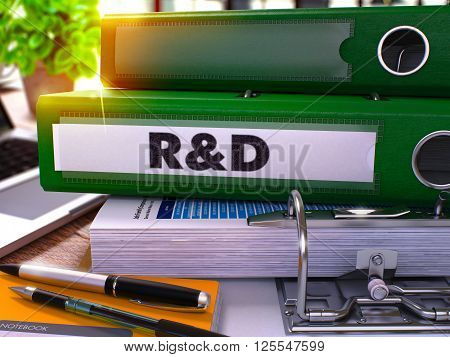Research and Development - Green Office Folder on Blurred Background of Working Table with Stationery and Laptop. Business Concept. Research and Development on Toned Image. 3D.