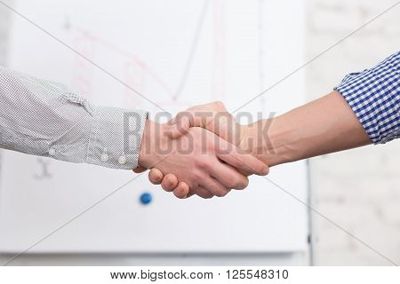 Business handshake concept. Business people agreed to sign contract or agreement in office. Two men are colleagues now.