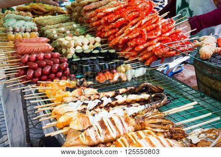 Meatballs  And Seafood On Sticks At A Market In Bangkok, Thailand