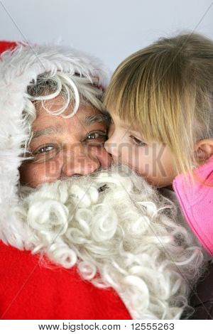 Portrait of Santa Claus carrying a little girl in his arms