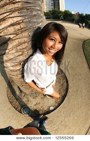 Beautiful Asian Girl Leaning To Palm Tree