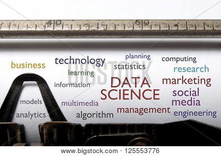 Data science word cloud printed on a typewriter