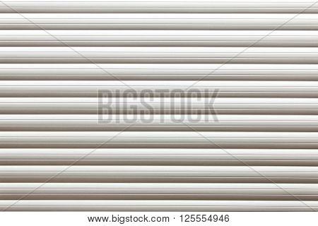 Roller shutter door. Striped textured white garage door background ** Note: Visible grain at 100%, best at smaller sizes