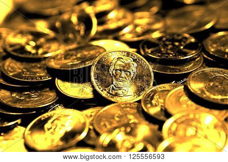 Pile of old coins representing wealth and luxary