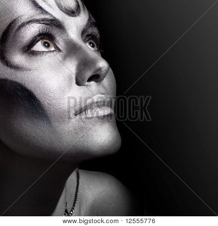 close-up portrait of beautiful woman with silver bodyart
