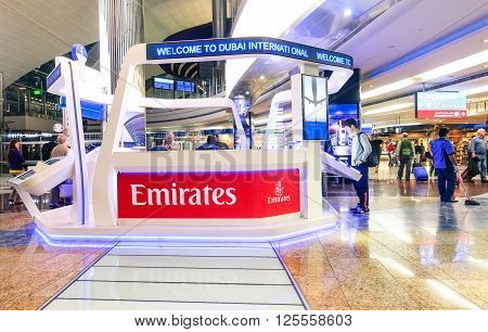 DUBAI UAE -January 10 2016: Emirates Airline help desk in Dubai International Airport. Emirates is the national airline of the Arabian Emirate of Dubai and it is part of The Fly Emirates Group