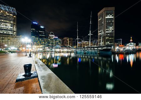 Waterfront Promenade And Modern Buildings At Night, At The Inner Harbor, In Baltimore, Maryland.