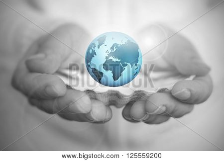 The world is your oyster, hands holding a world in a shell