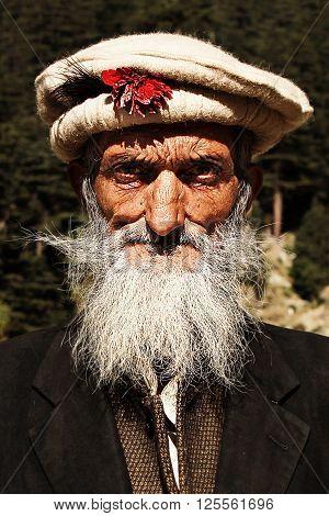 Kalaam, KPK, Pakistan - Oct 14 2015 -Tribesmen. An Old man Villager from swat During swat festival wearing cultural dress
