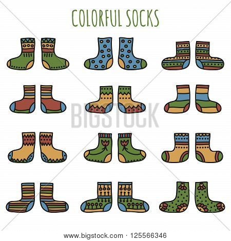 Set of colorful hand drawn socks with different patterns in desaturated colors on a white background. Vector illustration