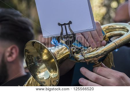 Trumpet being played in an event, holly week