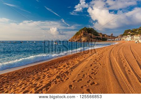 Sand Gran Platja beach and fortress in the morning in Tossa de Mar on Costa Brava, Catalunya, Spain