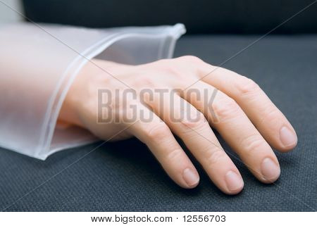 an artificial limb of a hand of the person