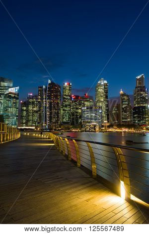 SINGAPORE, FEBRUARY 21 2016 : Boardwalk Singapore skyline and view of the financial district, Singapore on February 21 2016