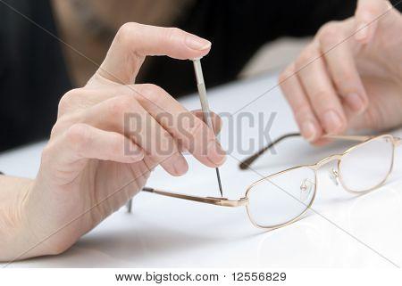 repairing glasses