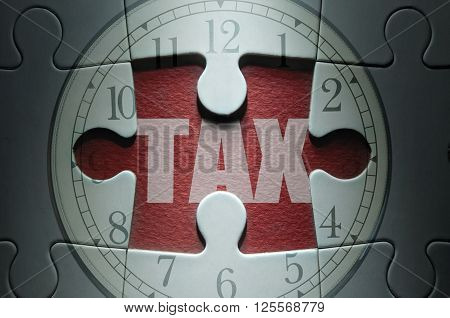 Missing piece from a clock jigsaw puzzle with tax in the center