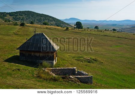 Rural wooden house at Pešter plateau panoramic landscape in southwest Serbia