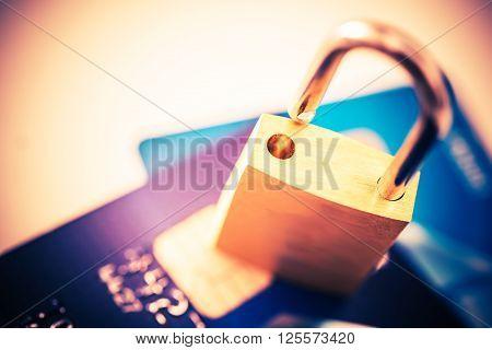 Not Safe Payments Concept. Padlock on Credit Cards Closeup Photo Concept.