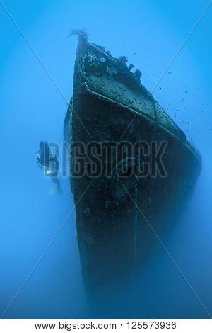 Scuba diver exploring shipwreck named Paris II
