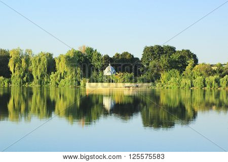 River through the park, gazebo on the river bank