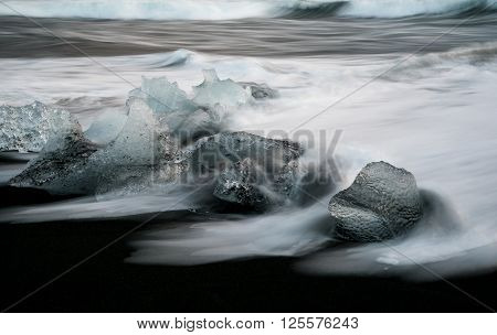 Icebergs from Vatnajokull glacier drop into Jokulsarlon lake and then to the Ice beach in Iceland.