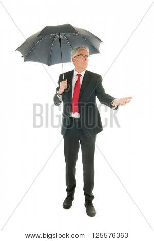 Formally dressed Senior business man with umbrella