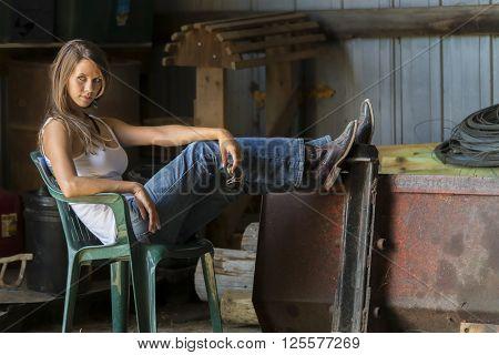 model posing as a farmers daughter in a rural environment