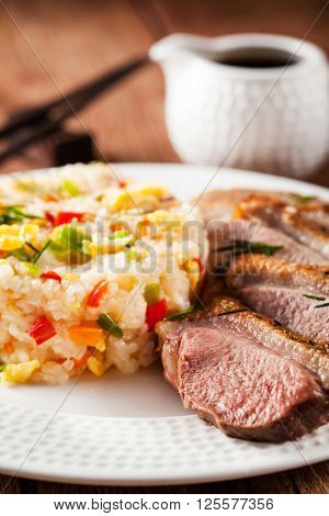Asian style food - fried duck breast and jasmine rice with vegetables and eggs ** Note: Visible grain at 100%, best at smaller sizes