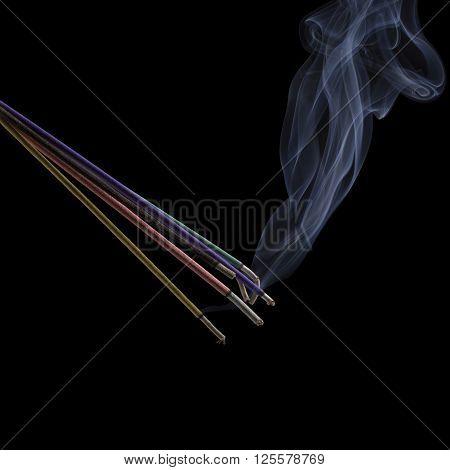 Burning incense sticks with smoke isolated on black