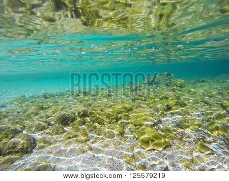 turquoise sea seen from underwater in Sardinia Italy
