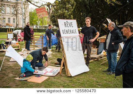 STRASBOURG FRANCE - APR 9 2016: Man near placard with
