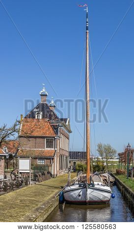 Old sailing ship in historical village Hindeloopen Netherlands