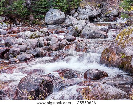 Stones And Mountain River With Small Waterfall, Selective Focus