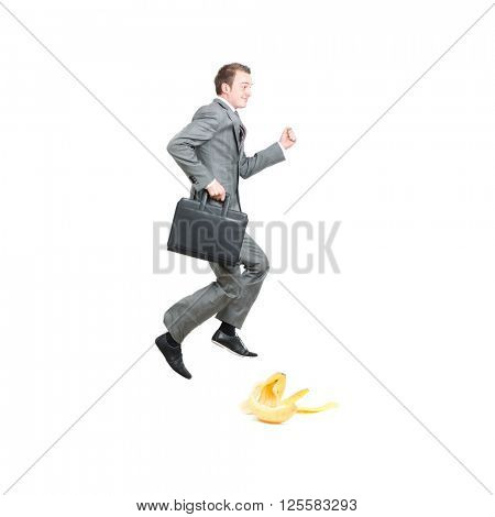 Businessman about to slip in bananapeel