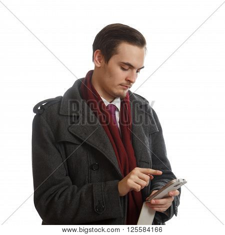 A young businessman working on his phone