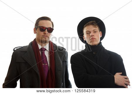 Two young well dressed businessman facing the camera
